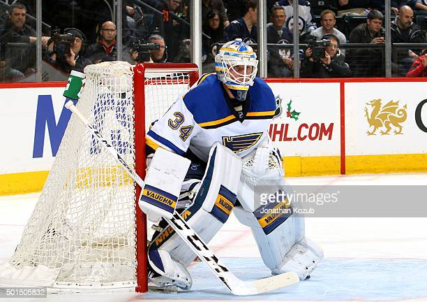Goaltender Jake Allen of the St Louis Blues keeps an eye on the play during second period action against the Winnipeg Jets at the MTS Centre on...