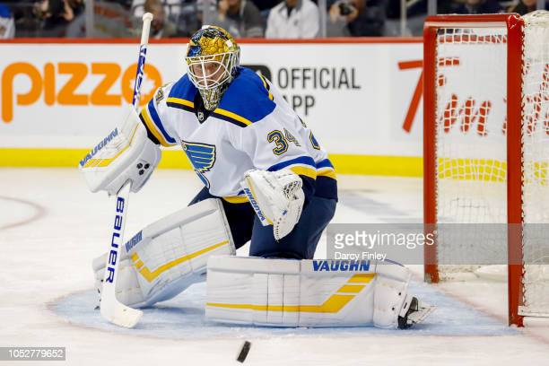 Goaltender Jake Allen of the St Louis Blues keeps an eye on the puck during first period action against the Winnipeg Jets at the Bell MTS Place on...