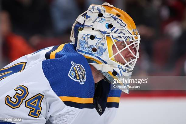 Goaltender Jake Allen of the St. Louis Blues looks down ice during the third period of the NHL game against the Arizona Coyotes at Gila River Arena...