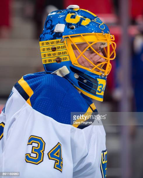 Goaltender Jake Allen of the St Louis Blues looks down the ice during warmups prior to an NHL game against the Detroit Red Wings at Little Caesars...