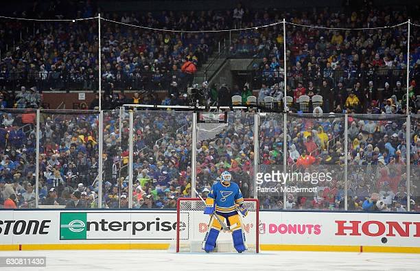 Goaltender Jake Allen of the St Louis Blues looks on from his net during the 2017 Bridgestone NHL Winter Classic game action at Busch Stadium on...