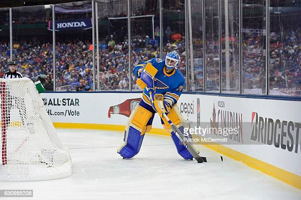 Goaltender Jake Allen of the St Louis Blues plays the puck behind the net during the 2017 Bridgestone NHL Winter Classic at Busch Stadium on January...