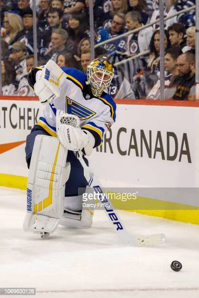 Goaltender Jake Allen of the St Louis Blues shoots the puck around the boards during first period action against the Winnipeg Jets at the Bell MTS...