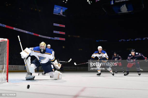 Goaltender Jake Allen of the St Louis Blues skates back towards the net as Alex Pietrangelo of the St Louis Blues and Matt Calvert of the Columbus...