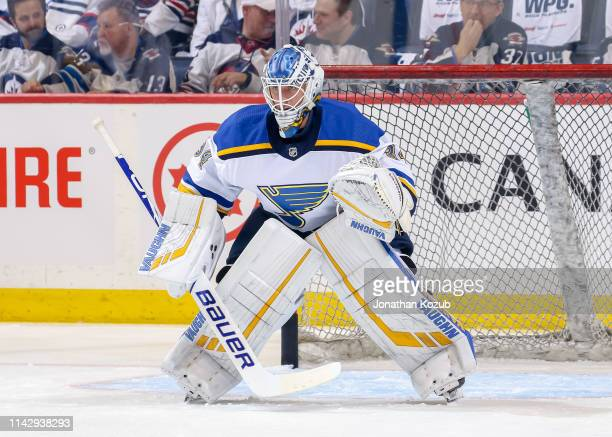 Goaltender Jake Allen of the St Louis Blues takes part in the pregame warm up prior to NHL action against the Winnipeg Jets in Game Two of the...