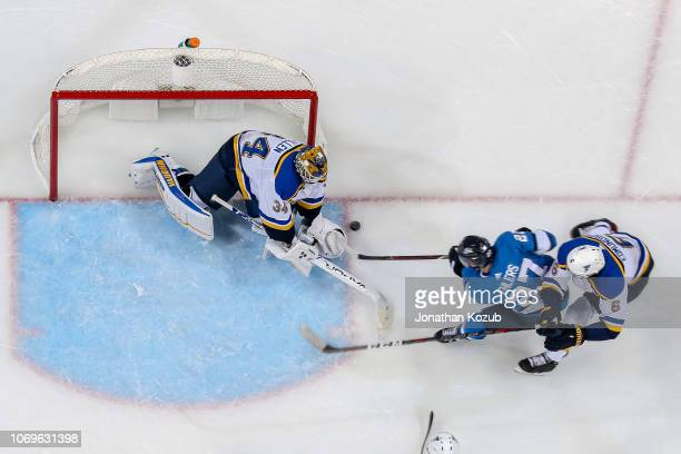 Goaltender Jake Allen of the St Louis Blues tries to cover the puck as Nikolaj Ehlers of the Winnipeg Jets drives towards the crease during second...