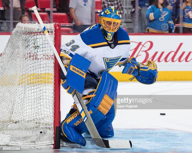 Goaltender Jake Allen of the St Louis Blues watches the puck during warmups prior to an NHL game against the Detroit Red Wings at Little Caesars...