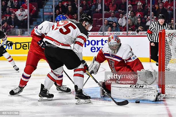 Goaltender Jakub Skarek of Team Czech Republic makes a pad save on Nicolas Roy of Team Canada during the 2017 IIHF World Junior Championship...