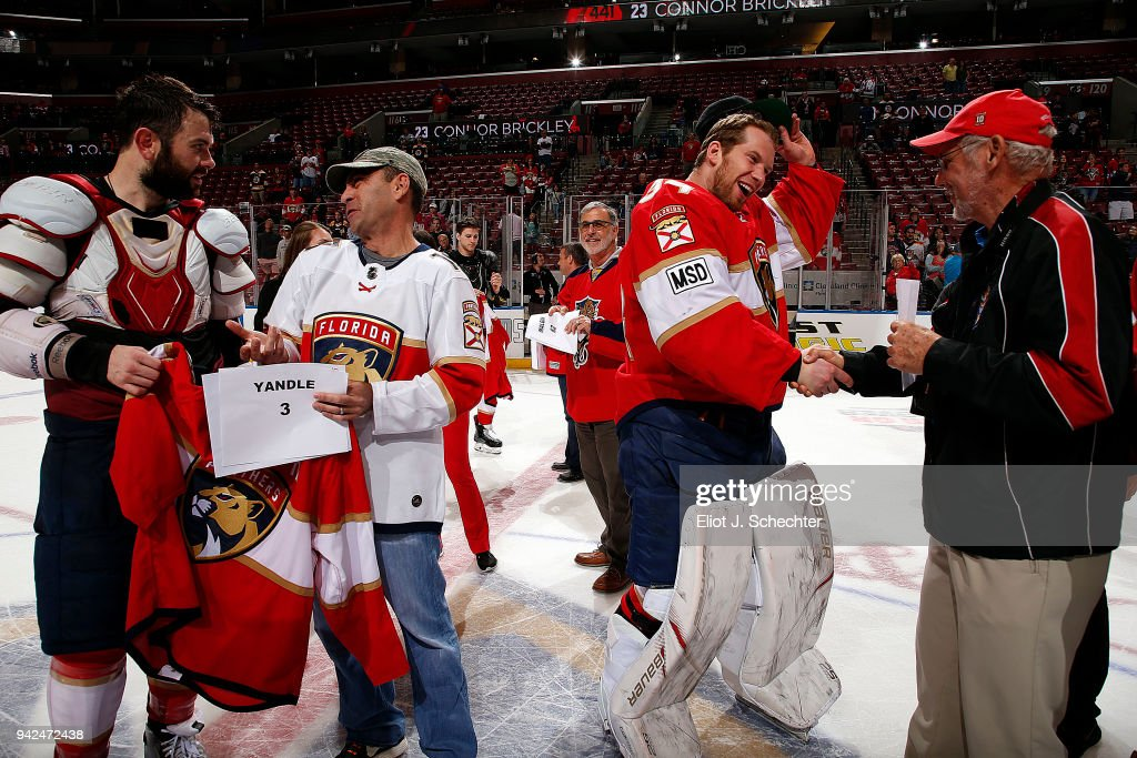 Goaltender James Reimer #34 and Keith Yandle #3 of the Florida Panthers give their game worn jerseys to fans after their 3-2 over the Boston Bruins at the BB&T Center on April 5, 2018 in Sunrise, Florida.