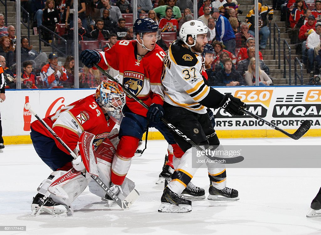 Goaltender James Reimer #34 looks towards the blue line as Michael Matheson #19 of the Florida Panthers checks Patrice Bergeron #37 of the Boston Bruins in front of the net at the BB&T Center on January 7, 2017 in Sunrise, Florida. The Bruins defeated the Panthers 4-0.