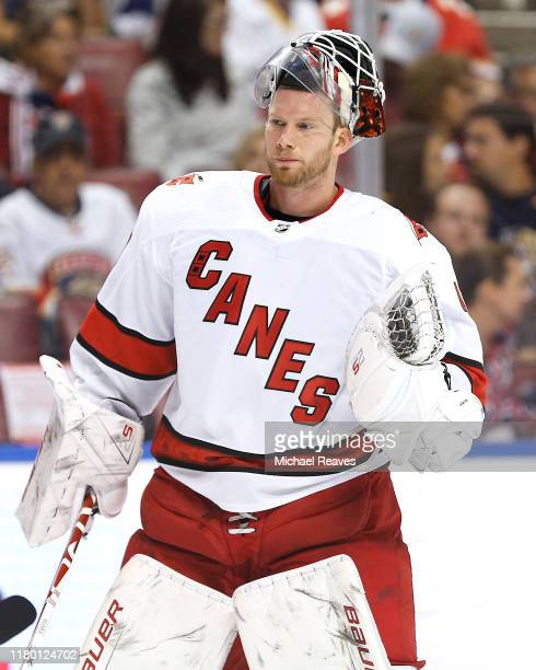 Goaltender James Reimer of the Carolina Hurricanes looks on against the Florida Panthers during the first period at BBT Center on October 08 2019 in...