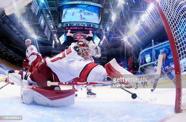 Goaltender James Reimer of the Carolina Hurricanes makes a save on a shot by Filip Chytil the New York Rangers in the second period of Game Three of...