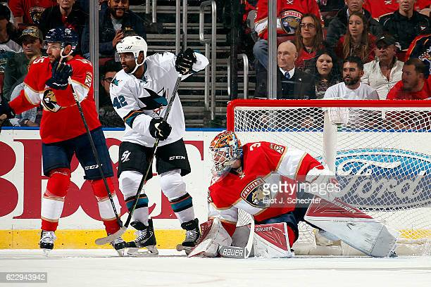 Goaltender James Reimer of the Florida Panthers and teammate Jason Demers defend the net against Joel Ward of the San Jose Sharks at the BBT Center...
