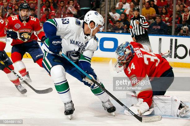 Goaltender James Reimer of the Florida Panthers defends the net against Bo Horvat of the Vancouver Canucks at the BBT Center on October 13 2018 in...