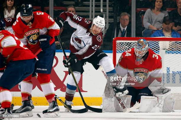 Goaltender James Reimer of the Florida Panthers defends the net against Colin Wilson of the Colorado Avalanche at the BBT Center on December 9 2017...