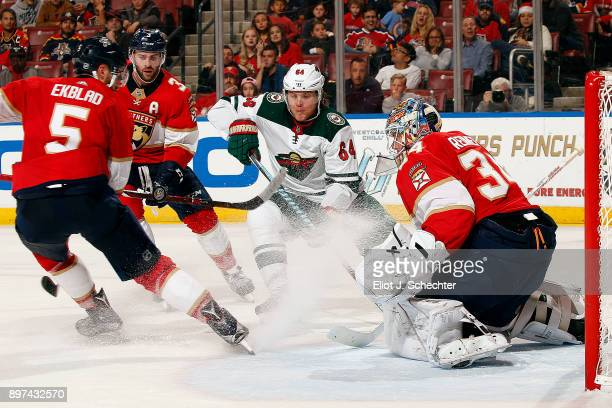 Goaltender James Reimer of the Florida Panthers defends the net against Mikael Granlund of the Minnesota Wild at the BBT Center on December 22 2017...