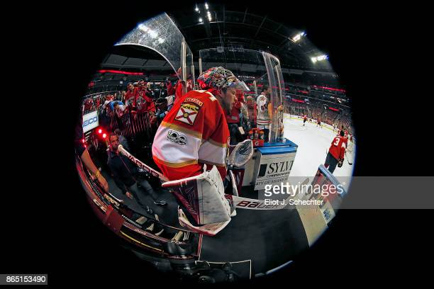 Goaltender James Reimer of the Florida Panthers heads out to the ice for warm ups against the Pittsburgh Penguins at the BBT Center on October 20...