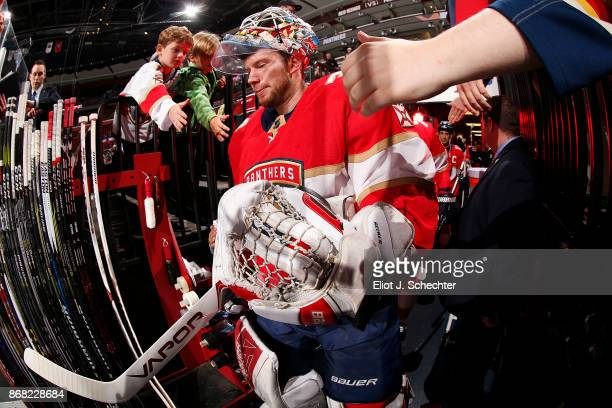 Goaltender James Reimer of the Florida Panthers heads out to the ice for warm ups prior to the start of the game against the Detroit Red Wings at the...