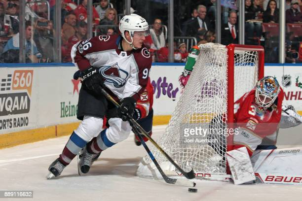 Goaltender James Reimer of the Florida Panthers looks back as Mikko Rantanen of the Colorado Avalanche cries the puck around the net during second...