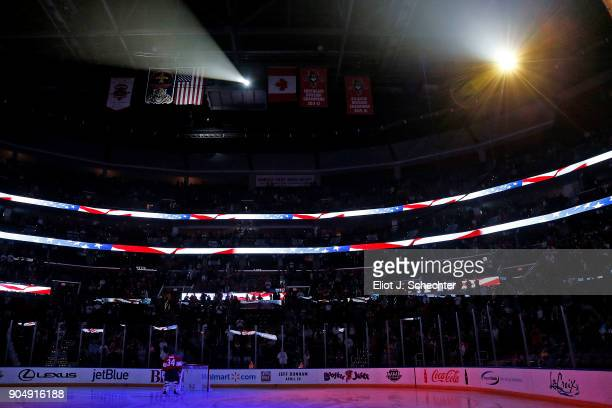 Goaltender James Reimer of the Florida Panthers stands on the ice for the national anthems prior to the start of the game against the Calgary Flames...