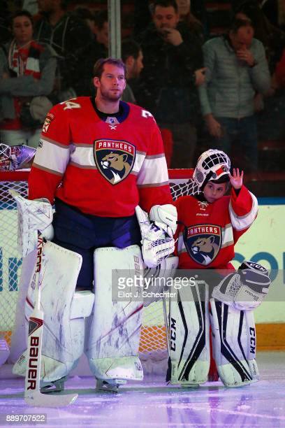 Goaltender James Reimer of the Florida Panthers stands on the ice with Reese MacKenzie Daughter of teammate Derek MacKenzie Prior to the start of the...