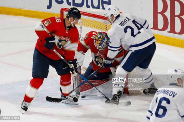 Goaltender James Reimer of the Florida Panthers stops a shot by Brian Boyle of the Toronto Maple Leafs as Jakub Kindl of the Panthers defends at the...