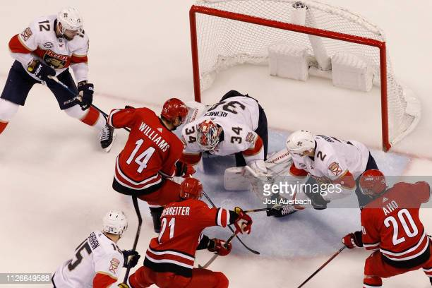 Goaltender James Reimer of the Florida Panthers stops a shot by Justin Williams of the Carolina Hurricanes during third period action at the BBT...