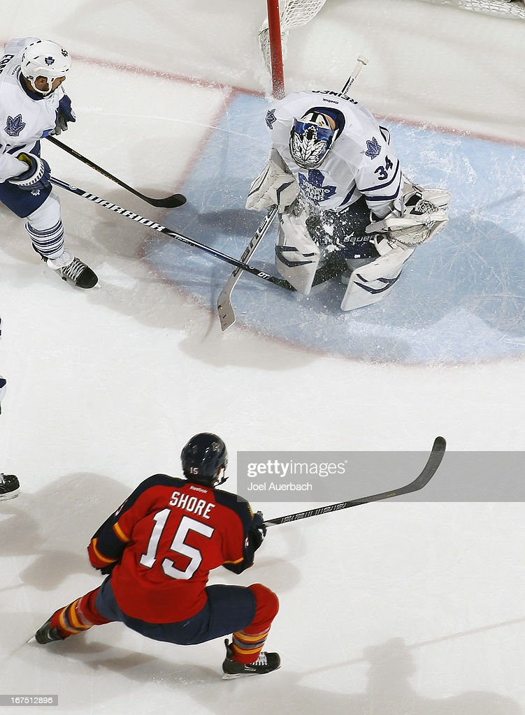 Goaltender James Reimer #34 of the Toronto Maple Leafs stops a shot by Drew Shore #15 of the Florida Panthers at the BB&T Center on April 25, 2013 in Sunrise, Florida. The Maple Leafs defeated the Panthers 4-0.