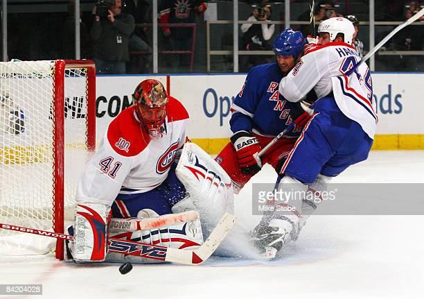Goaltender Jaroslav Halak and Roman Hamrlik of the Montreal Canadiens denies Aaron Voros of the New York Rangers at Madison Square Garden January 7...