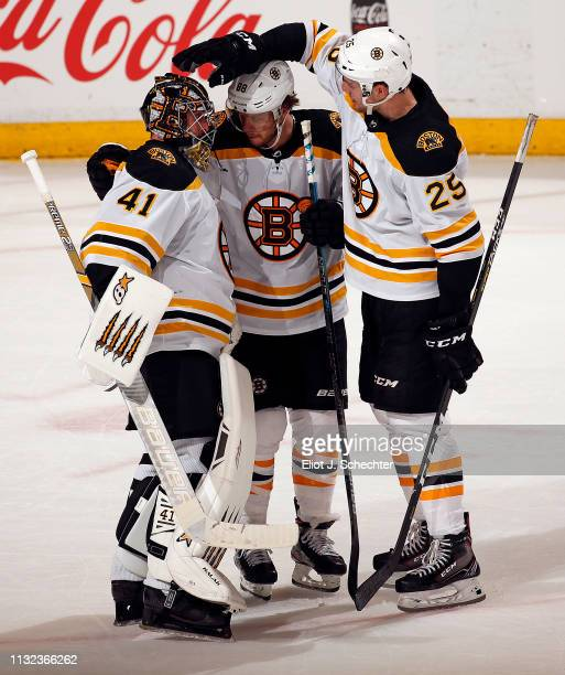 Goaltender Jaroslav Halak of the Boston Bruins celebrate their 73 win with teammates David Pastrnak and Brandon Carlo against the Florida Panthers at...