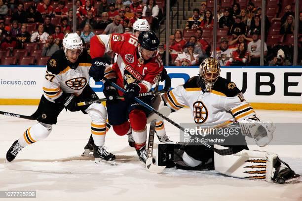Goaltender Jaroslav Halak of the Boston Bruins defends the net with the help of teammate John Moore against Aleksander Barkov of the Florida Panthers...