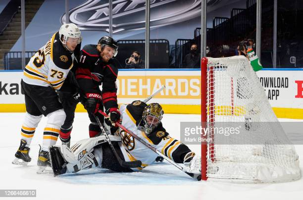 Goaltender Jaroslav Halak of the Boston Bruins makes a save on Jordan Staal of the Carolina Hurricanes in the first period of Game Three of the...