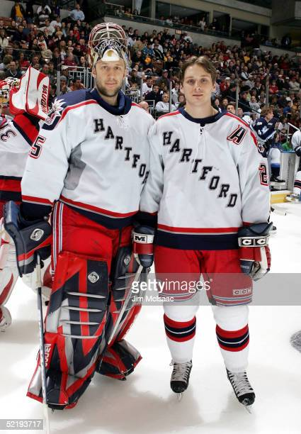 Goaltender Jason LaBarbera and defenseman Lawrence Nycholat of the Hartford Wolfpack pose during the American Hockey League All Star Skills...