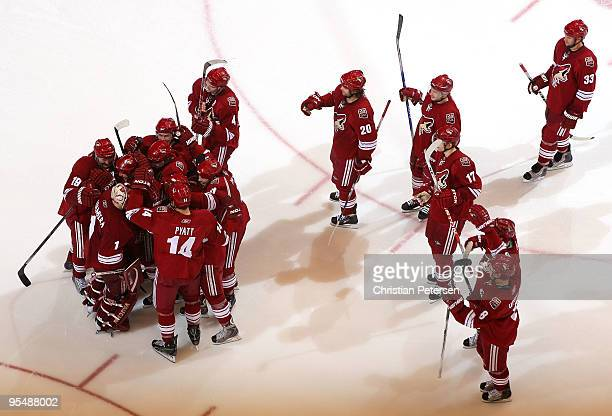 Goaltender Jason LaBarbera of the Phoenix Coyotes is congratulated by teammates after defeating the Vancouver Canucks in the NHL game at Jobingcom...