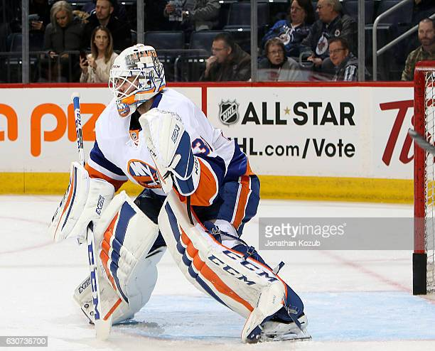 Goaltender JeanFrancois Berube of the New York Islanders takes part in the pregame warm up prior to NHL action against the Winnipeg Jets at the MTS...