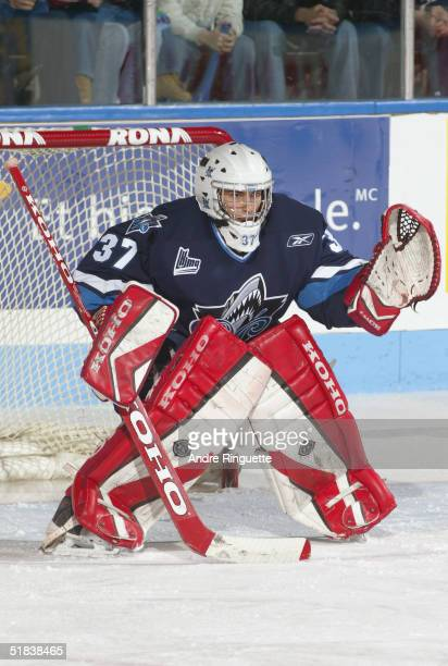 Goaltender Jean-Michel Filiatrault of Rimouski Oceanique skates defends the net against the Gatineau Olympiques during the Quebec Major Junior Hockey...