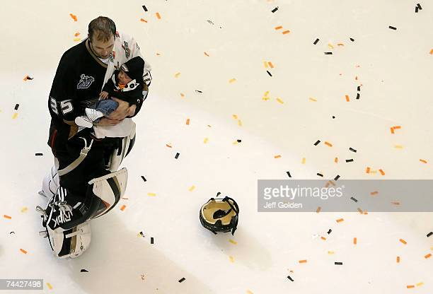 Goaltender JeanSebastien Giguere of the Anaheim Ducks holds his infant son Maxime after defeating the Ottawa Senators in Game Five of the 2007...