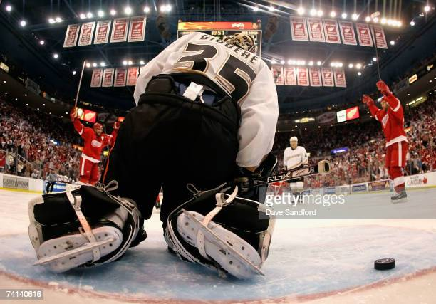 Goaltender JeanSebastien Giguere of the Anaheim Ducks reacts after giving up a third period goal to Pavel Datsyuk of the Detroit Red Wings during...