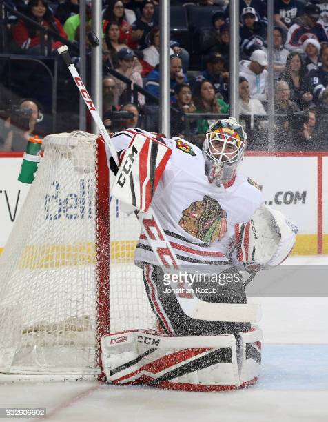 Goaltender JF Berube of the Chicago Blackhawks deflects the puck away from the goal during second period action against the Winnipeg Jets at the Bell...