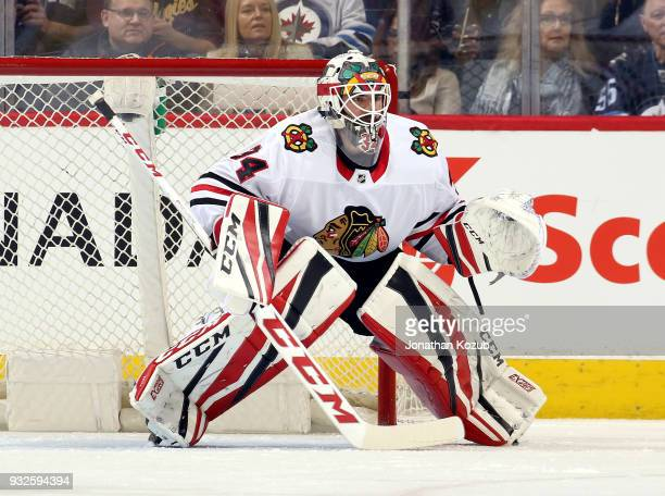 Goaltender JF Berube of the Chicago Blackhawks guards the net during first period action against the Winnipeg Jets at the Bell MTS Place on March 15...