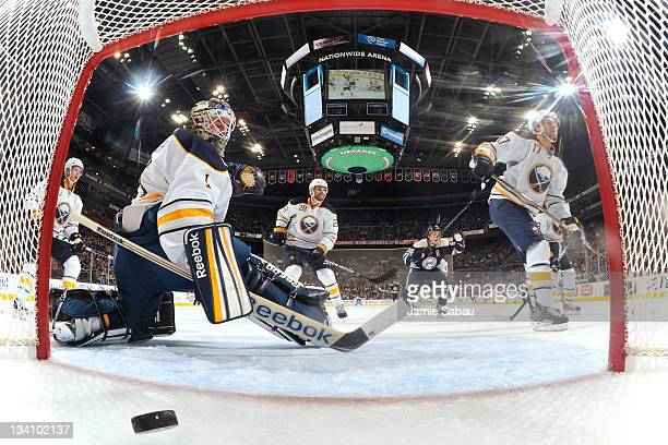 Goaltender Jhonas Enroth of the Buffalo Sabres looks back toward the net after Mark Letestu of the Columbus Blue Jackets buried a rebound for the...