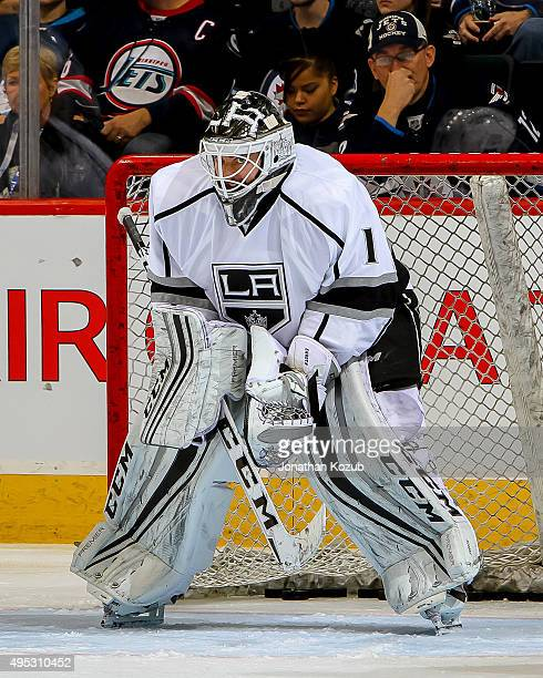 Goaltender Jhonas Enroth of the Los Angeles Kings takes part in the pregame warm up prior to NHL action against the Winnipeg Jets at the MTS Centre...