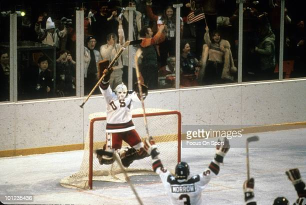 Goaltender Jim Craig of United States Olympic Hockey team jump with jubilation after the United States beat the Soviet Union hockey team in the...