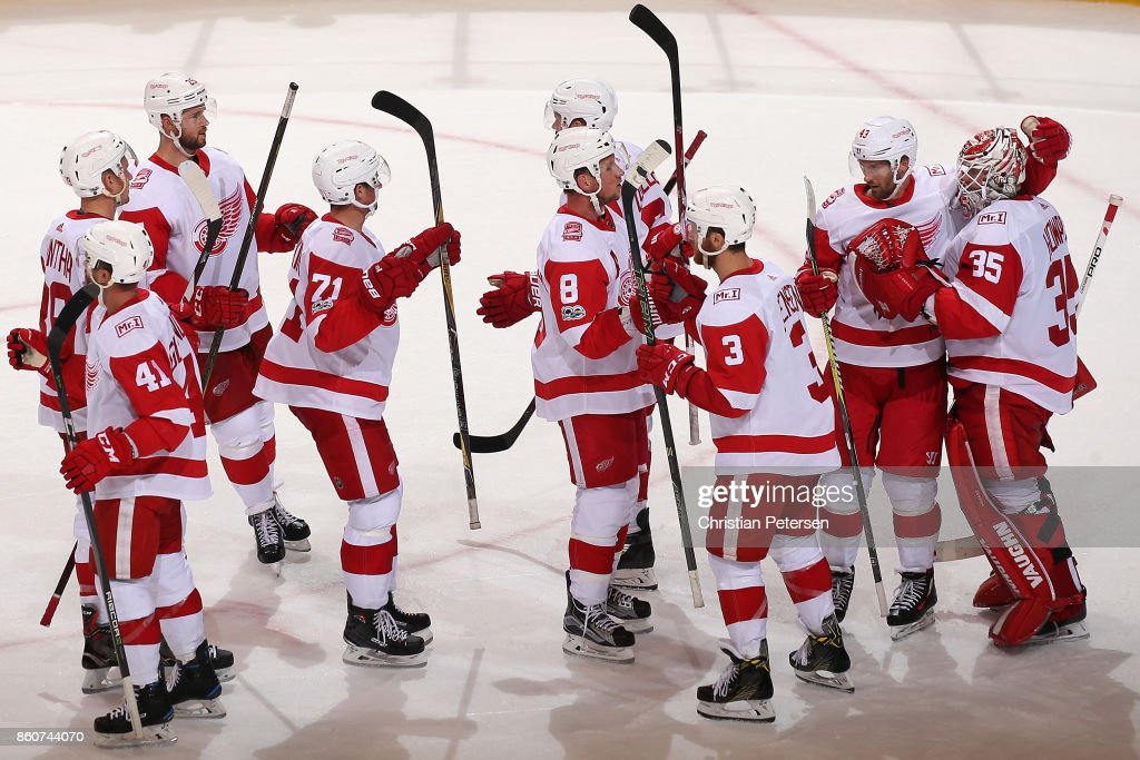 Goaltender Jimmy Howard #35 of the Detroit Red Wings is congratulated by Darren Helm #43 and teaammates after defeating the Arizona Coyotes in the NHL game at Gila River Arena on October 12, 2017 in Glendale, Arizona. The Red Wings defeated the Coyotes 4-2.