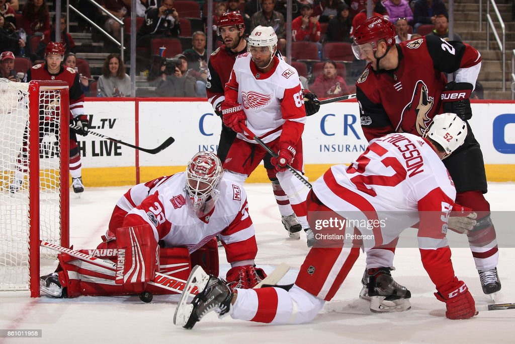 Goaltender Jimmy Howard #35 of the Detroit Red Wings makes a pad save as Derek Stepan #21 of the Arizona Coyotes looks for a rebound during the third period of the NHL game at Gila River Arena on October 12, 2017 in Glendale, Arizona. The Red Wings defeated the Coyotes 4-2.