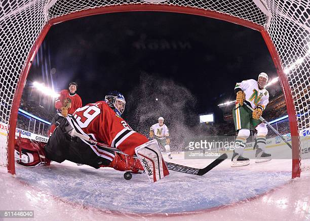 Goaltender Jimmy Waite of the Chicago Blackhawks Alumni makes a save on a shot by Mike Modano of the Minnesota North Stars Alumni during the 2016...