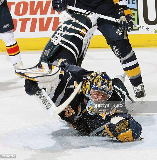 Goaltender Jocelyn Thibault of the Buffalo Sabres dives but can't stop the shot of Olli Jokinen of the Florida Panthers for their fourth goal on...
