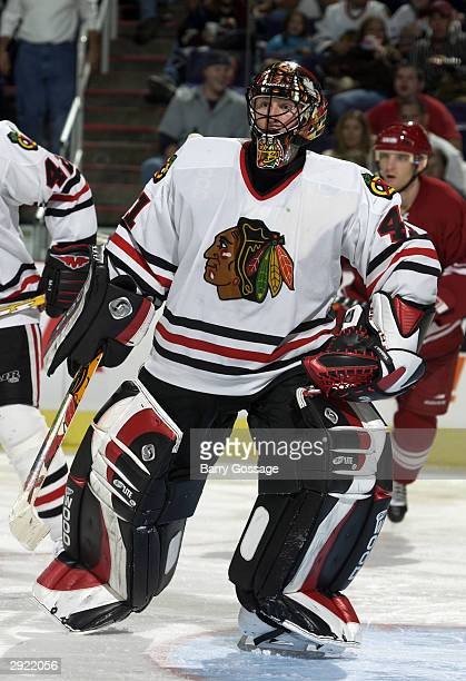 Goaltender Jocelyn Thibault of the Chicago Blackhawks faces the play during the game against the Phoenix Coyotes on October 28 2003 at America West...