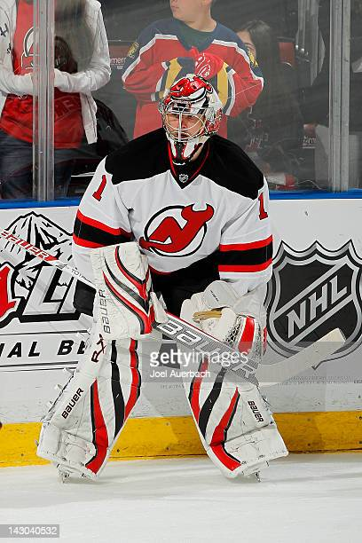 Goaltender Johan Hedberg of the New Jersey Devils watches the Florida Panthers warm up prior to Game Two of the Eastern Conference Quarterfinals...