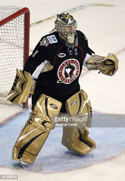 Goaltender John Curry of the Wilkes-Barre/Scranton Penguins looks on of the Chicago Wolves during the Calder Cup Finals on June 10, 2008 at the...
